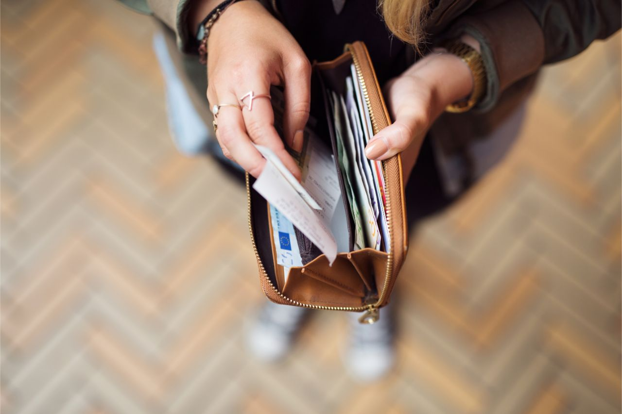 A woman placing an official receipt inside her wallet