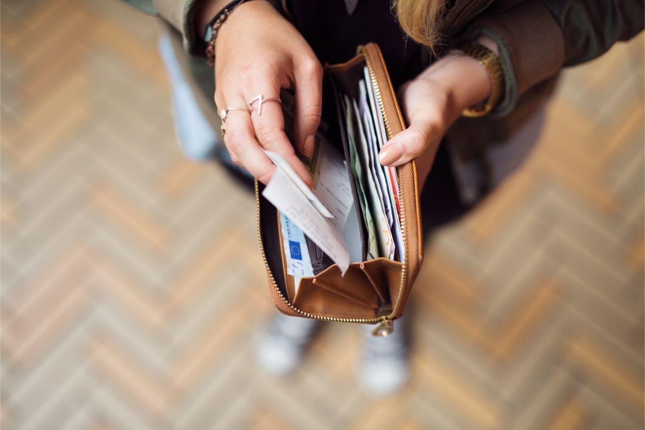 A woman placing an official receipt inside her wallet